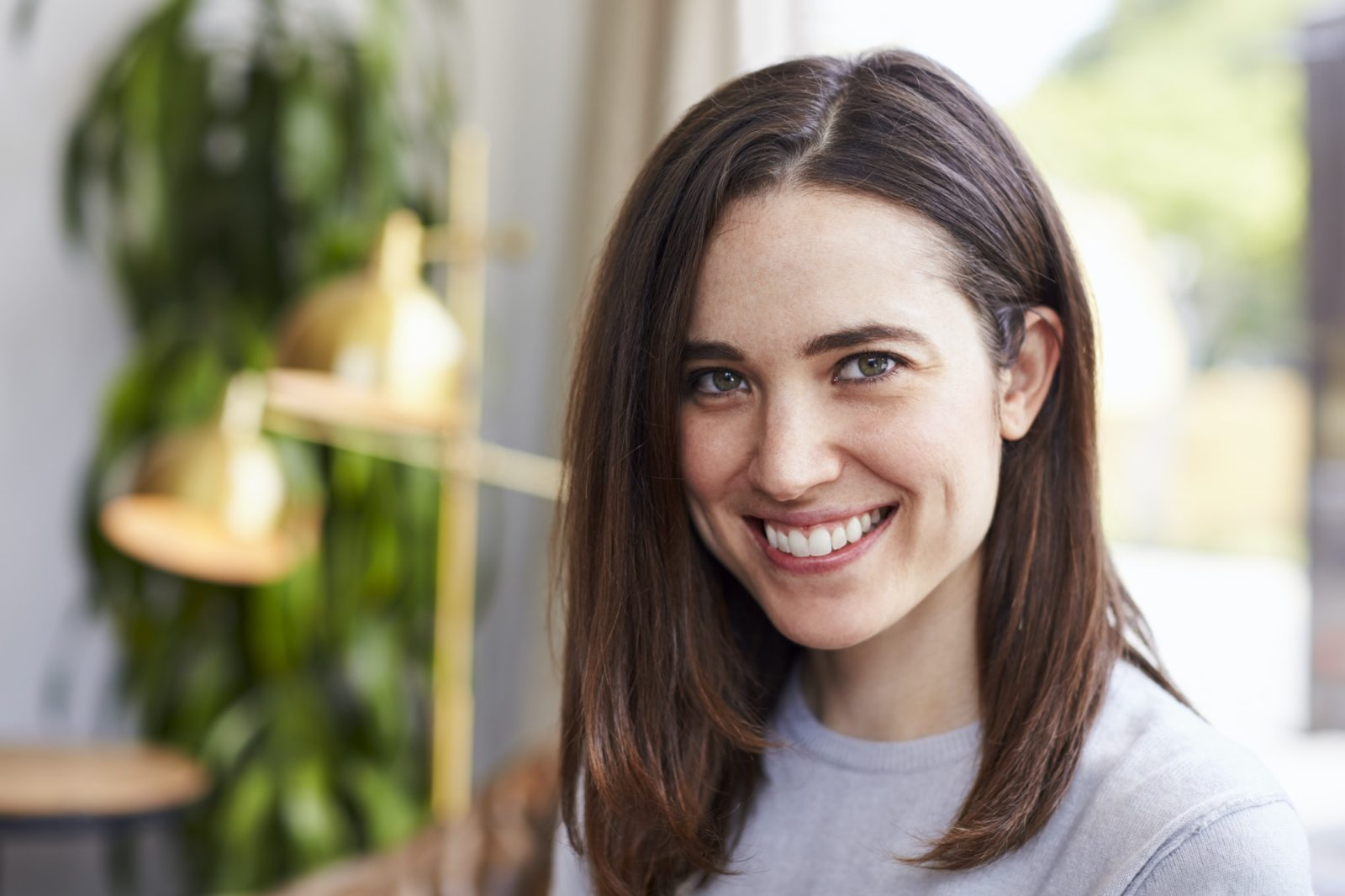 Young smiling white female business owner, portrait