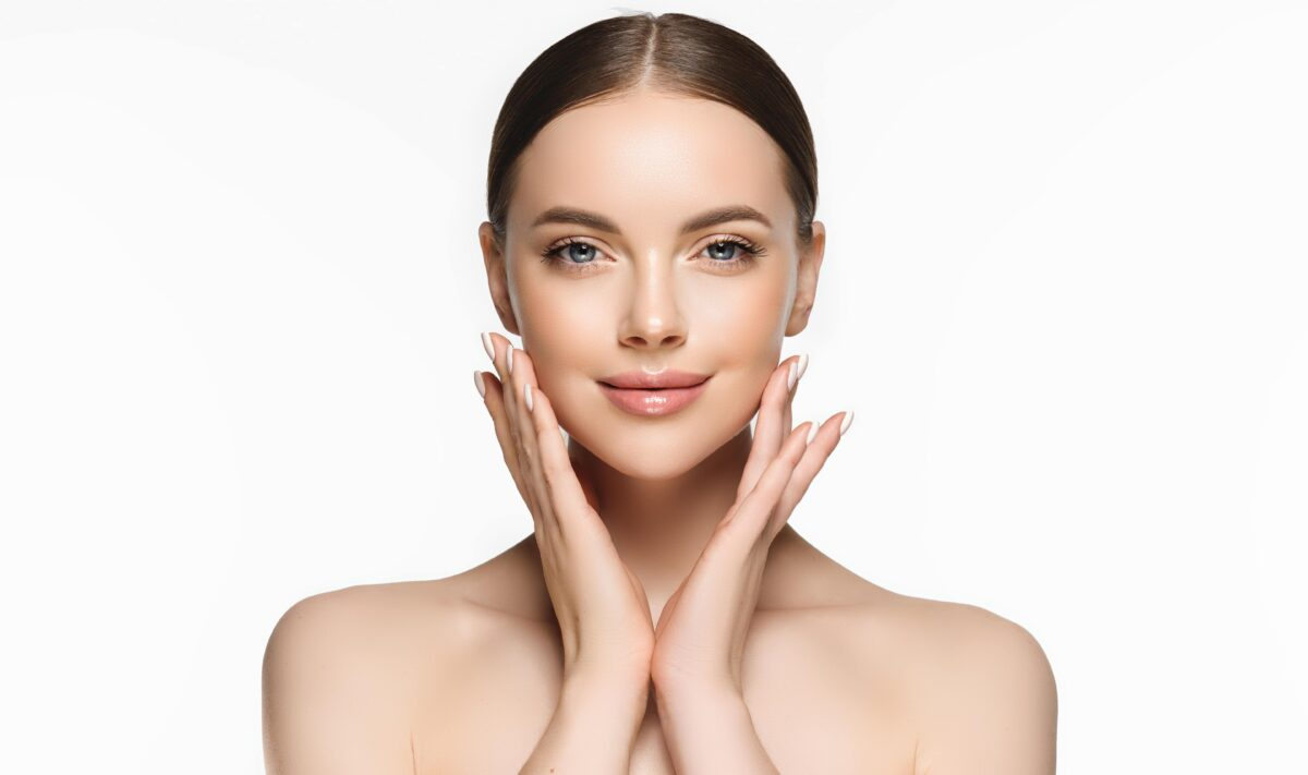 Beautiful young woman with clean fresh skin on face